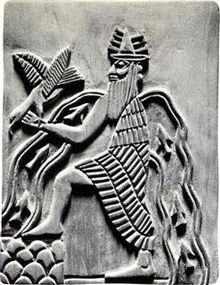 The Mesopotamian god Enki atop the mountain, with waters of gnosis flowing from his shoulders and sacred fish swimming against the stream.